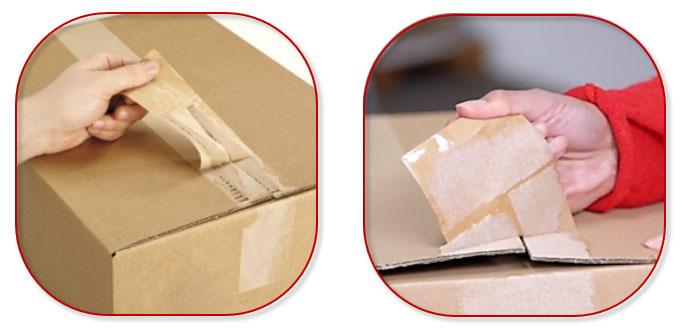 Poging tot openen van een kartonnen doos